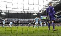 Leicester rock Man City to race clear, Spurs second