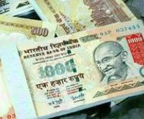 Rupee rebounds 26 paise to end at 59.93