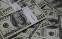Dollar down on mixed U.S. data ahead of Fed decision