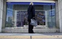 Oil gains, Deutsche Bank weighs on stocks; yen cuts losses