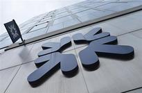 Britain to look at RBS split, start Lloyds sale soon