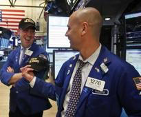 Dow, S&P 500 at records as Fed-driven rally continues