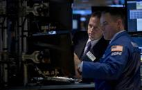 Wall St hits session highs; investors digest Fed statement