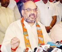 Amit Shah lists NDA feats to silence Congress