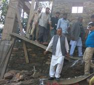 Haq hands over relief cheques to cloudburst victims