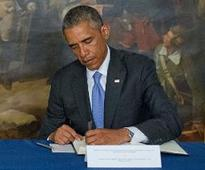 Obama signs bill giving Congress a say on Iran nuclear deal