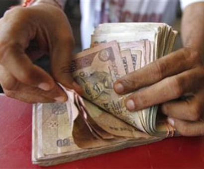 Rupee falls 22 paise against dollar in early trade