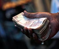Rupee surges by 50 paise, closes at 63.11