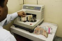 Rupee closes marginally higher against dollar at 61.32