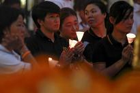 Thai police hunt 2 bombing suspects after raids