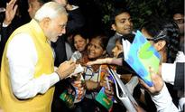 Selfies, autographs and handshakes: PM Modi a hit with Indians in