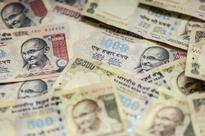 Rupee erases losses to trade higher at 66.17 per US dollar