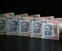 Rupee ends at one-week high on dollar selling