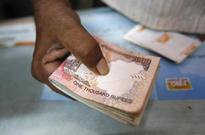 Rupee trades marginally lower, month-end dollar demand seen