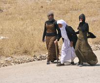 Iraq: Kurdish, Yazidis fighters battle Islamic State for strategic town of Sinjar