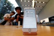 Apple's holiday surprise: big sales, not so big profits