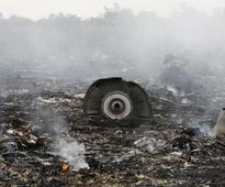 MH17 crash: Plane carrying remains of victims on way to Netherlands
