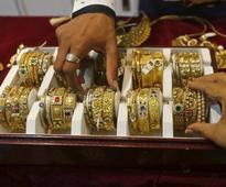 Gold bounces up from two and a half week low as dollar, shares fall