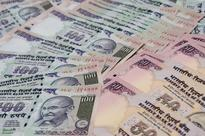 Rupee ends higher at 61.61 per dollar