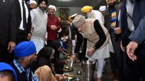 Heart of Gold: Watch PM Modi serve langar to devotees at the Golden Temple