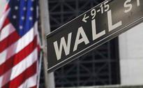 Wall Street Falls on Simmering Greece Worries, Tepid Data