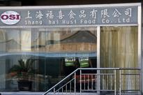 China probes firms, food safety scare spreads