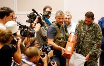 Flight MH17: Ukraine Separatists Hand Over Bodies, Black Boxes to Malaysian Experts