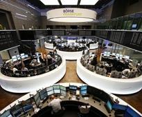 Global stocks fall on mixed data; oil rebounds