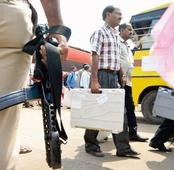 Armed for D-Day: Police, polling officials