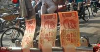 Rupee falls 22 paise to 61.29 against dollar