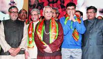 Two UPA II mandarins join BJP