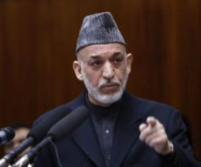 Karzai arrives in India; to seek military aid