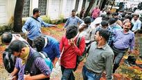 US charges 61 people in Indian call center scam