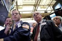 Wall St. dips on consumer, healthcare; Fed in focus