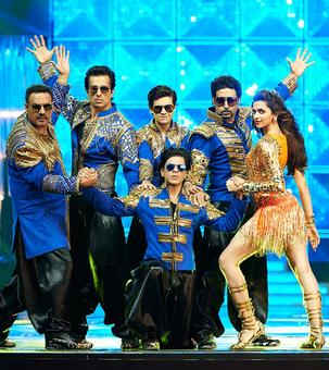 Like Shah Rukh in blue and gold or in a pink tutu? VOTE!
