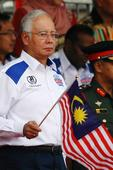 Defiant Malaysian PM rejects calls to step down