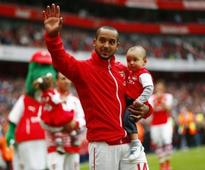 Walcott hat-trick gives Wenger FA Cup final headache