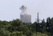 West agrees wider sanctions as Kiev says forces near crash site