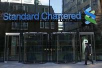 Standard Chartered halves dividend, new CEO says could raise capital