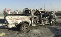 Three suicide bombs, 12 mortars hit Shi'ite Baghdad district