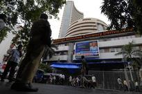 Sensex trades marginally lower; CIL, M&M fall