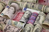 Dollar hits more than eight-month high, euro weakens