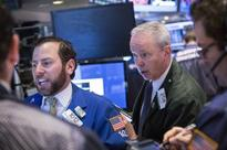 Wall Street lower after payrolls; Apple to join Dow