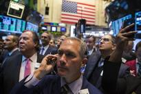 Wall St slips after six-day S&P run; biotechs drop