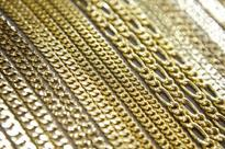 Spot gold prices slip as dollar holds gains after US jobs data