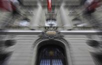SNB imposes negative interest rates to stem flight into franc